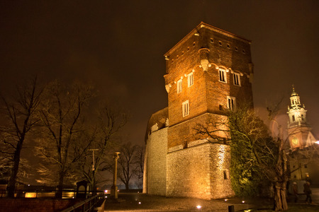 extant: Medieval Thieves tower at night. Is tower - one of the three extant fully towers at Wawel Castle. It was built in the XIV century in the line of gothic defensive wall and was rebuilt by the Austrians. Editorial