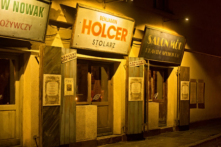 szeroka: POLAND, KRAKOW - JANUARY 01, 2015: Szeroka Street at night in Kazimierz with prewar views, is now the well-known restaurant Polakowski. Kazimierz is the former jewish quarter of Krakow.