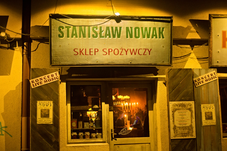 POLAND, KRAKOW - JANUARY 01, 2015: Szeroka Street in Kazimierz with prewar views, is now the well-known restaurant Polakowski. Kazimierz is the former jewish quarter of Krakow.
