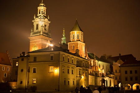 View of the Wawel Royal Archcathedral Basilica of Saints Stanislaus and Wenceslaus and Wawel castle on the Wawel Hill at winter night, Krakow, Poland.