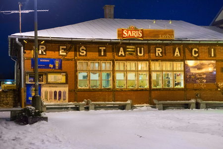SLOVAKIA, TATRANSKA LOMNICA - JANUARY 05, 2015: Traditional old half-timber restaurant in the building of the railway station. The town is known as skiing and hiking resort in High Tatras mountains.