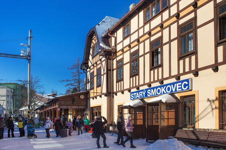 SLOVAKIA, STARY SMOKOVEC - JANUARY 06, 2015: Rush hour at railway station Stary Smokovec in High Tatras mountains. Is a popular resort for skiing and hiking. And junction of the Tatra Electric Railway