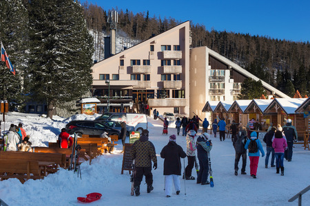 SLOVAKIA, STRBSKE PLESO - JANUARY 06, 2015: Hotel Fis in Strbske Pleso. The village is a favorite ski, tourist, and health resort in the slovakian part of High Tatras mountains.