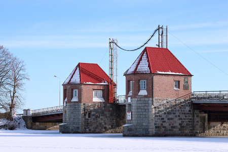 movable bridge: POLESSK, KALININGRAD REGION, RUSSIA - JANUARY 30, 2011: Old german movable bridge known as Eagle (Adler Brucke) through Deima river in the city of Polessk (Labiau). The bridge was built in 1919-1922. Editorial