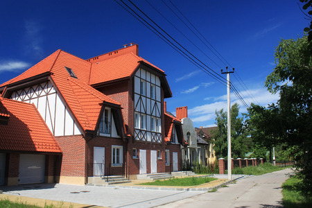 MORSKOE, KALININGRAD REGION, RUSSIA - JUNE 19, 2011: New cottages in the style of half-timbered houses in the Morskoe (Pillkoppen) village in the Curonian Spit National Park. Russia.