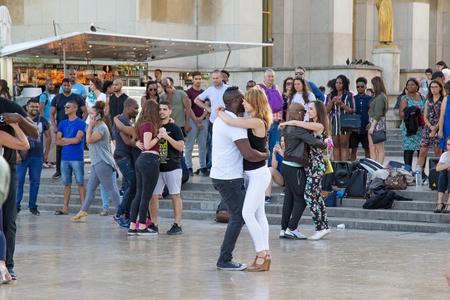 PARIS, FRANCE - JUNE 24, 2017: Unknown young people dancing on the Place de Trocadero near Palais de Chaillot in Paris. Editorial