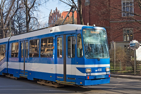 tramway: KRAKOW, POLAND - MARCH 28, 2017: Tram MAN N8S-NF in the historic part of Krakow. Total in Krakow more than 90 kilometers of tram tracks and 24 routes.
