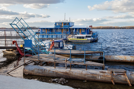 View from embankment on the old wooden dock house on the Volga river in Samara city, Russia.