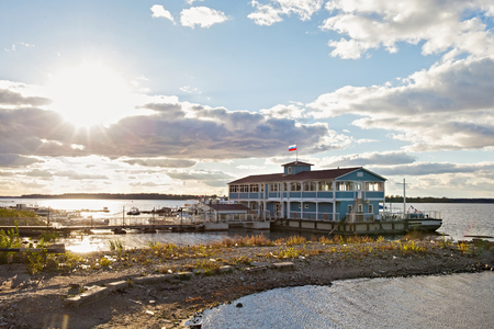 View from embankment on the old wooden dock house (now restaurant Old Pier) on the Volga river in Samara city, Russia.
