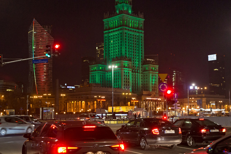 WARSAW, POLAND - JANUARY 01, 2016: Night traffic near of the Palace of Culture and Science. Constructed in 1955 is the tallest building in Poland. It is was designed by Soviet architect Lev Rudnev.