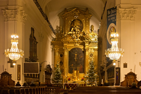 WARSAW, POLAND - JANUARY 02, 2016: Interior of the Roman Catholic Church of the Holy Cross (XV-XVI cent.) in Christmas decorations. Is a one of the most notable Baroque churches in Polands capital.