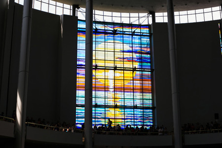 KRAKOW, POLAND - MAY 28, 2016: Colorful vitrage in Basilica of the Divine Mercy of Sanctuary in Lagiewniki. Millions of pilgrims from around the world visit sanctuary every year. Editorial