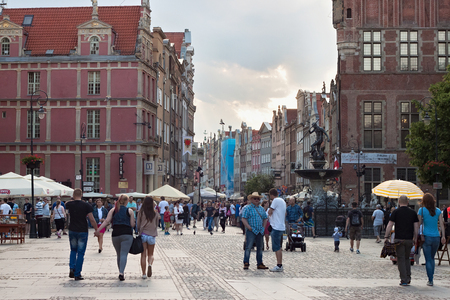 GDANSK, POLAND - JUNE 07, 2014: Unknown people walking on the Long Market square in the center of Gdansk. The Long Market is one of the most notable tourist attractions of the city.