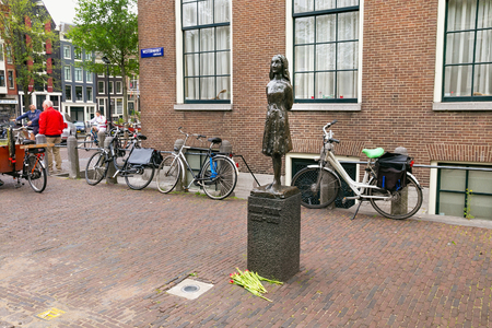 AMSTERDAM, NETHERLANDS - JUNE 25, 2017: Anne Frank statue on Westerkerk Plaza near the Anne Frank House. Anne Frank was a German-born diarist. One of the most discussed Jewish victims of the Holocaust 에디토리얼