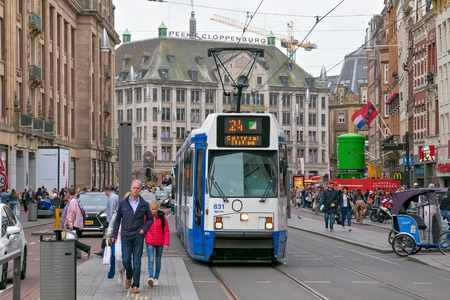 AMSTERDAM, NETHERLANDS - JUNE 25, 2017: BN Constructions Ferroviaires tram Serie 12G in historical part of Amsterdam opposite the Madame Tussauds museum. 스톡 콘텐츠 - 118945887