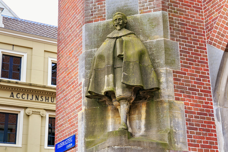 AMSTERDAM, NETHERLANDS - JUNE 25, 2017: Sculpture of the Hugo de Groot (Grotius) by sculptor Lambertus Zijl on the Oudebrugsteeg st. Hugo Grotius was a famous Dutch jurist of the XVII century. Editorial