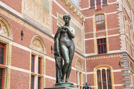 Bronze statue of a naked woman near the Rijksmuseum Dutch national museum of arts and history in Amsterdam, Netherlands.