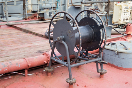 Black winch with on the ship deck.