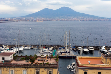 NAPLES, ITALY - OCTOBER 31, 2015: View of the volcano Vesuvius and the Gulf of Naples. Mount Vesuvius is best known for its eruption in AD 79 that led to the destruction of the Roman city of Pompeii.