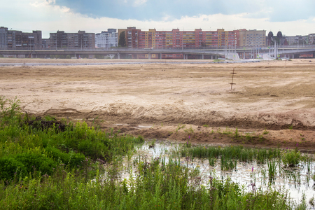 Wasteland (territory for new stadium) in a residential area on the suburb of Kaliningrad near the island of Lomze. Russia.