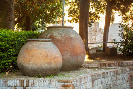 Large antique pots near of the ruins of the Flavian Amphitheater in Pozzuoli. Southern Italy. Imagens