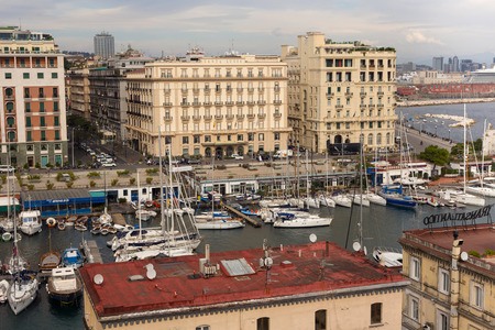 NAPLES, ITALY - OCTOBER 31, 2015: Air view of the Grand Hotel Santa Lucia and Hotel Excelsior in historical center of Naples near gulf embankment. Viiw from the castle Castel dell'Ovo. Redakční