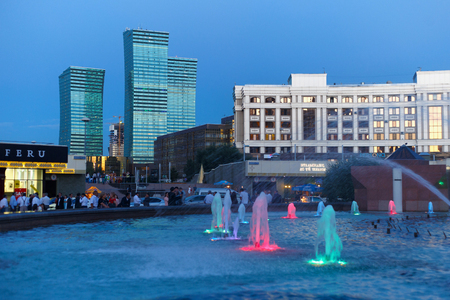 ASTANA, KAZAKHSTAN - JULY 25, 2017: Night view of the modern high-rise buildings and fountain the center of Astana city. Astana is the capital city of Kazakhstan and the second-largest city. Editöryel