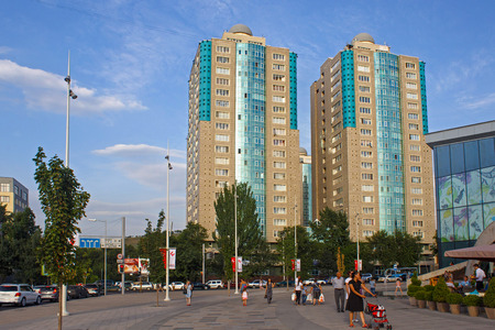 ALMATY, KAZAKHSTAN - JULY 27, 2017: View of the modern high-rise residential buildings in center of Almaty at summertime. Almaty is the largest city in Kazakhstan.