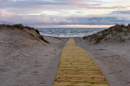 Boardwalk to the Parnu Bay in evening in overcast whether. It a bay in the northeastern part of the Gulf of Livonia (Gulf of Riga of Baltic Sea), in southern Estonia. Stock fotó