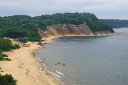 View of the cliffs, sandy beach and a beautiful cove on the Baltic Sea.