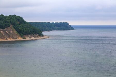 View of the sandy cliffs and a beautiful cove on the Baltic Sea.