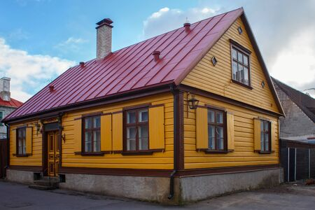Old wooden yellow building with freshly painted walls in historical center of Parnu, Estonia. 스톡 콘텐츠