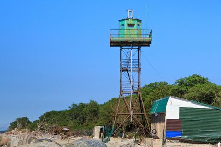 Old observation tower on the sand beach in the Baltic Sea coast.