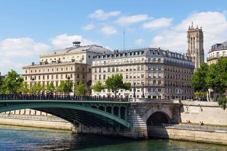 PARIS, FRANCE - JUNE 23, 2017: View of the old historical buildings, Theatre de la Ville (City Theatre or Sarah-Bernhardt) and Pont Notre-Dame bridge in central part of Paris at summertime.