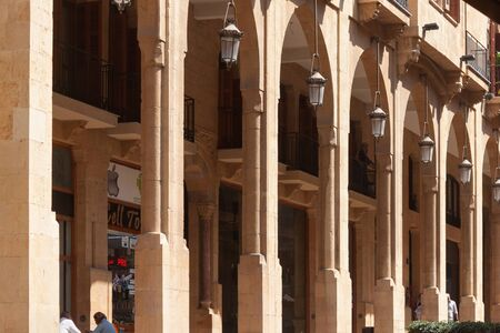 BEIRUT, LEBANON - AUGUST 14, 2014: Arches of the historical buildings at Rue Maarad street in Beirut Central District (Centre Ville) at summer sunny day.