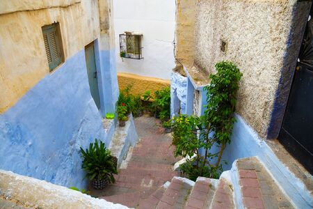 View of the one of the old colorful streets in the Tangier Medina quarter in Northern Morocco. A medina is typically walled, with many narrow and maze-like streets.