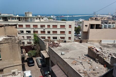 Old shabby roofs and walls of buildings near Mediterranean Sea in northern part of Beirut. Lebanon.
