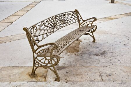 Iron bench with decorative elements on the street in Tangier, Northern Morocco.