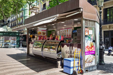 BARCELONA, SPAIN - MAY 16, 2017: Stand with the different ice creams on the famous pedestrian street La Rambla in historical center of Barcelona.