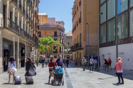 BARCELONA, SPAIN - MAY 15, 2017: View of the historical buildings on the Avinguda del Portal de l Angel street in center of Barcelona in sunny day.