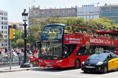BARCELONA, SPAIN - MAY 16, 2017: View of the red city tour bus in historical center of Barcelona in sunny day.