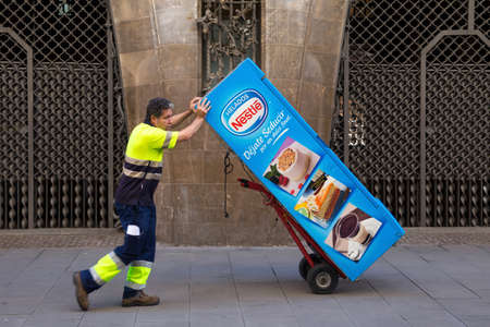BARCELONA, SPAIN - MAY 15, 2017: Unknown worker take away coffee automat in center of Barcelona. Editorial