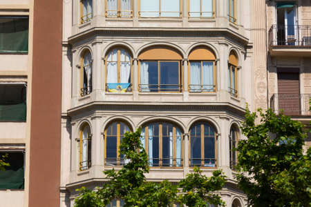 BARCELONA, SPAIN - MAY 15, 2017: Details of the one of the typical old residential buildings in modern style in the historical center of Barcelona in sunny day. 에디토리얼