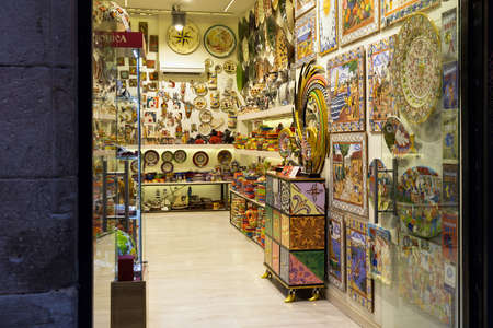BARCELONA, SPAIN - MAY 15, 2017: Entrance to the one of the souvenir stores in center of Barcelona.