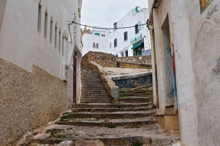 TANGIER, MOROCCO - MAY 26, 2017: Old stone staircase in the Tangier Medina quarter in Northern Morocco. A medina is typically walled, with many narrow and maze-like streets.