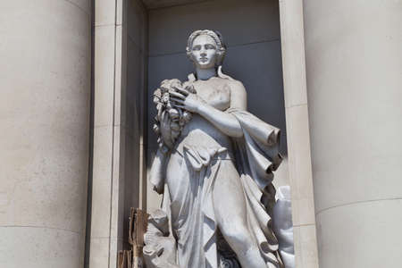 BARCELONA, SPAIN - MAY 16, 2017: Sculpture with woman in the facade of Iberostar Hotel building on the Paseo de Gracia street in center of Barcelona. 에디토리얼