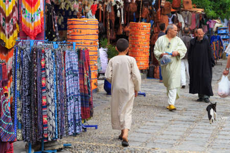 CHEFCHAOUEN, MOROCCO - MAY 28, 2017: Unknown local people in center of Chaouen. The city is noted for its buildings in shades of blue and that makes Chefchaouen very attractive to visitors.