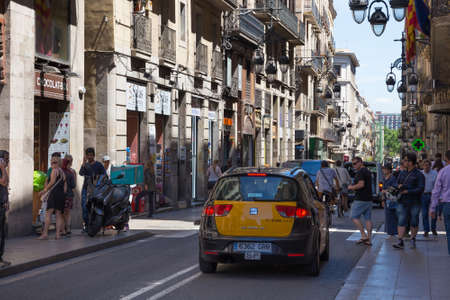 BARCELONA, SPAIN - MAY 15, 2017: View of the Carrer de Jaume I street in historical center of Barcelona in sunny day.