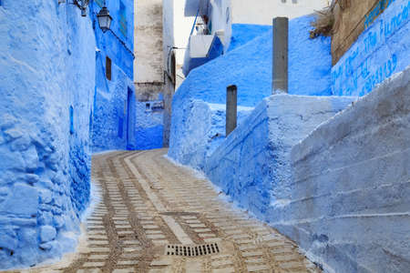 CHEFCHAOUEN, MOROCCO - MAY 28, 2017: View of the blue walls of Medina in Chaouen. The city is noted for its buildings in shades of blue and that makes Chefchaouen very attractive to visitors. Éditoriale