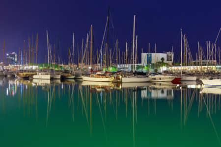 BARCELONA, SPAIN - MAY 16, 2017: View of the sailboats on the pier in center of Barcelona in evening time.